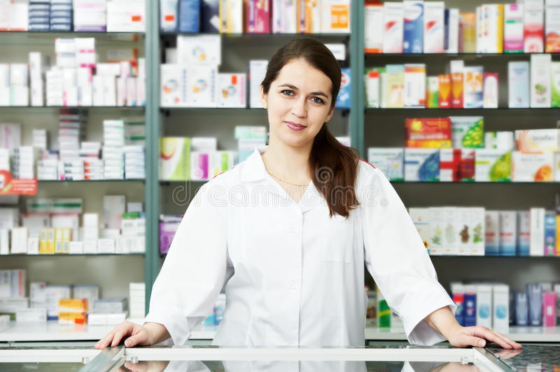 Pharmacy chemist woman in drugstore royalty free stock photography