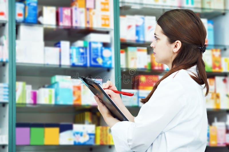 Pharmacy chemist woman in drugstore royalty free stock image
