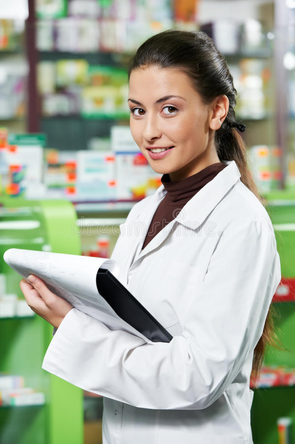 Download Pharmacy Chemist Woman In Drugstore Stock Photo - Image: 21659994