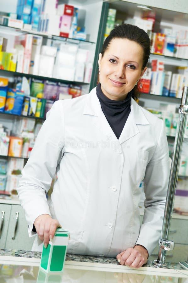 Pharmacy chemist woman in drugstore stock photos