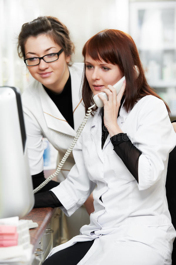 Pharmacy chemist women in drugstore with phone royalty free stock photos