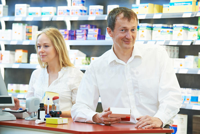 Download Pharmacy Chemist Workers In Drugstore Stock Photo - Image: 32352234