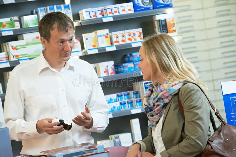 Pharmacy chemist workers in drugstore royalty free stock photo