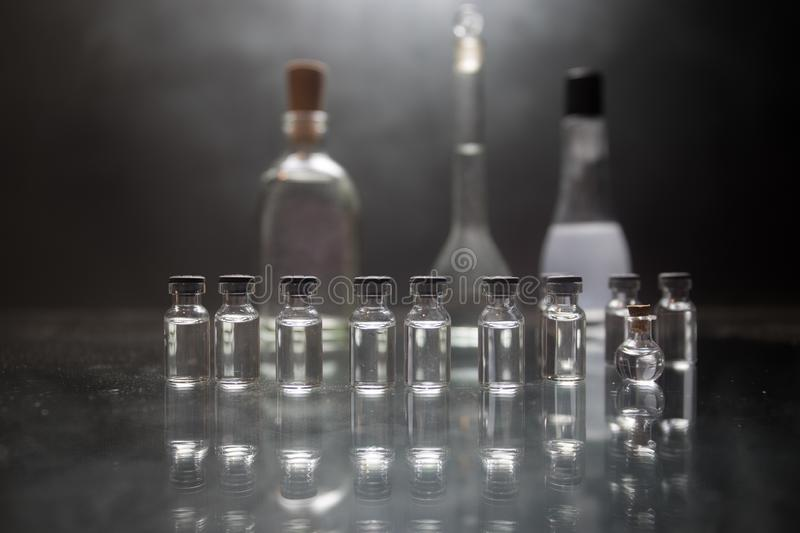Pharmacy and chemistry theme. Test glass flask with solution in research laboratory. Science and medical background. Laboratory royalty free stock images