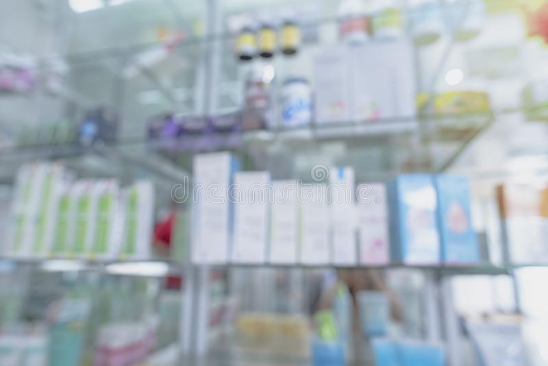 Blurred Pharmacy drugstore. Pharmacy drugstore retail Interior blur background with healthcare product on medicine cabinet.Pharmacy interior with blurred stock photography