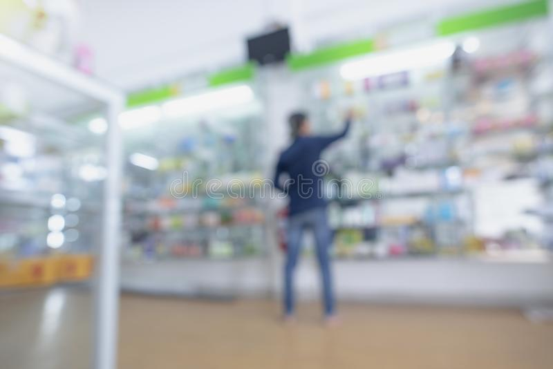 Blurred Pharmacy drugstore. Pharmacy drugstore retail Interior blur background with healthcare product on medicine cabinet.Pharmacy interior with blurred stock photos