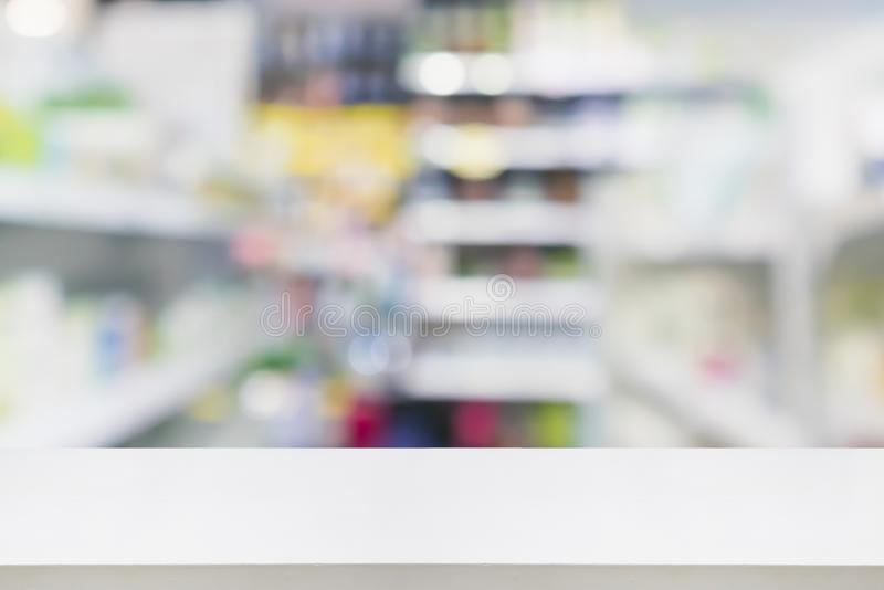 Pharmacy drugstore shop interior blur background. Pharmacy drugstore shop interior with medicines vitamins supplement and over the counter healthcare product for royalty free stock photos