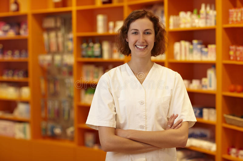 Pharmacy in front of shelves royalty free stock photo