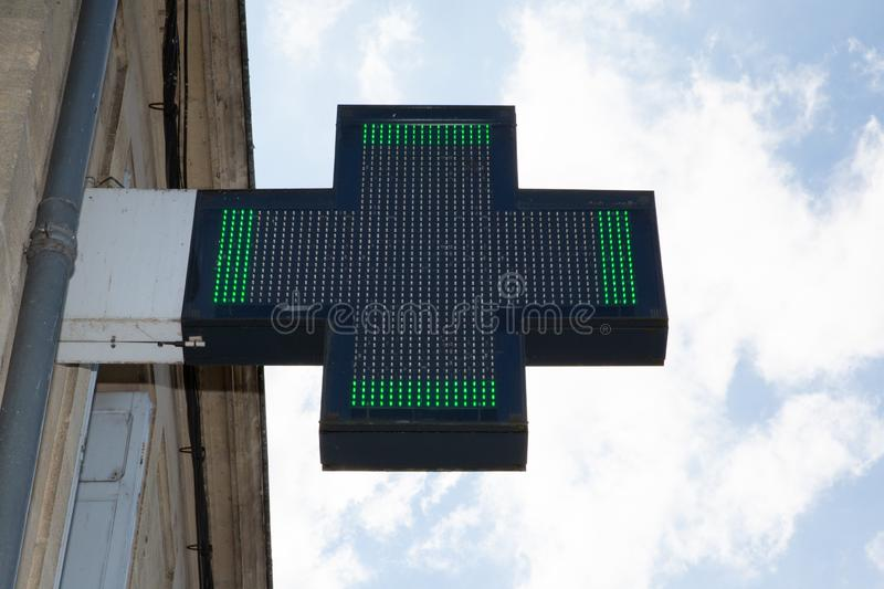 Pharmacy green cross sign in street shop. A Pharmacy green cross sign in street shop royalty free stock image