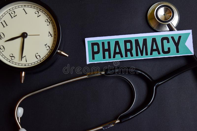 Pharmacy on the paper with Healthcare Concept Inspiration. alarm clock, Black stethoscope. stock images