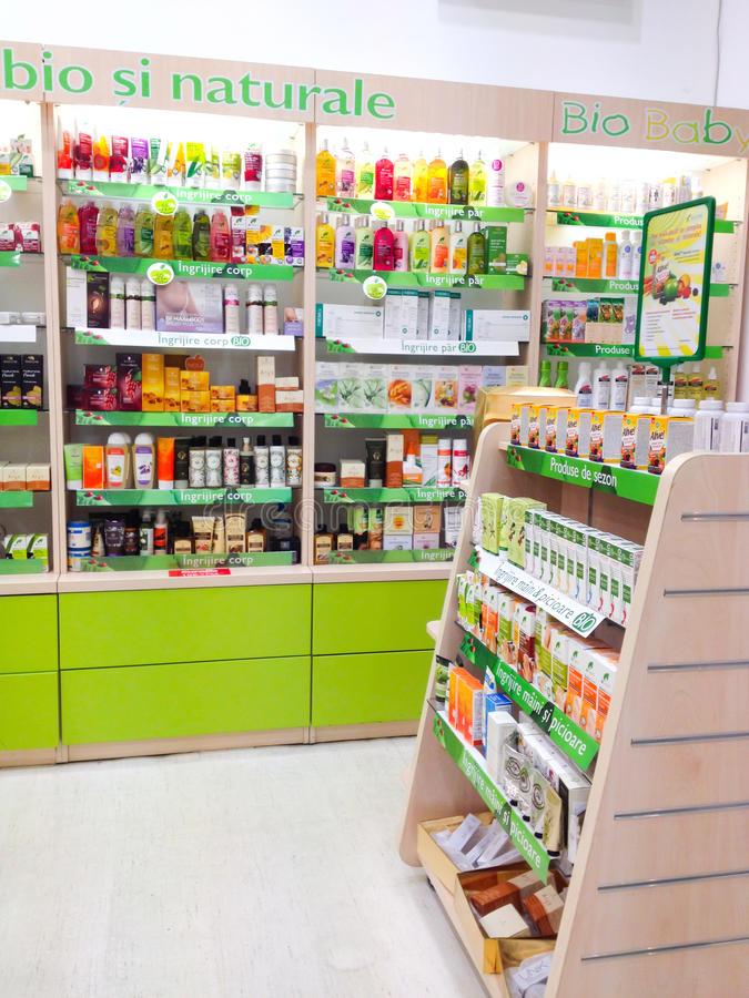 Pharmacy shop. Inside pharmacy shop in Romania. Shelves with bio and natural medicines royalty free stock image