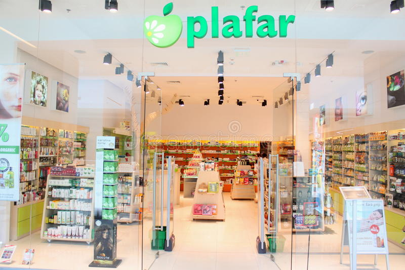 Pharmacy shop - plafar. Pharmacy shop plafar in Romania. Shelves with bio and natural medicines royalty free stock images