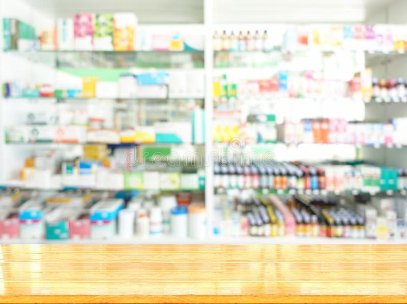Pharmacy shop. Wooden tabletop with blurred of pharmacy shop royalty free stock photos