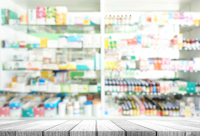 Pharmacy shop. Wooden tabletop with blurred of pharmacy shop stock photography