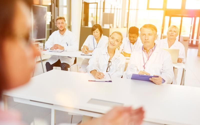 Pharmareferent in front of group doctors at the seminar stock photo