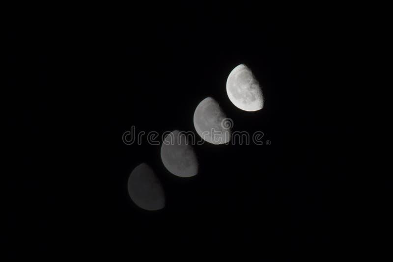 Phases lunaires sur fond noir brun photos stock
