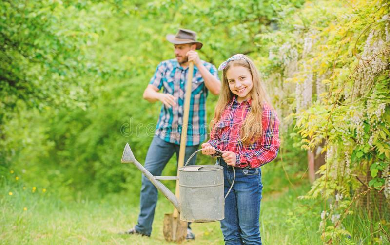 Phases of moon help determine best time plant garden. Planting flowers. Family dad and daughter planting plants royalty free stock image