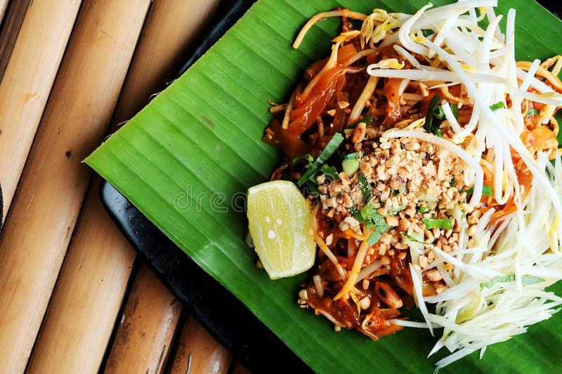 Phat thaior Pad thai is a famous Thailand tradition cuisine with fried noodle served on banana leaf royalty free stock images