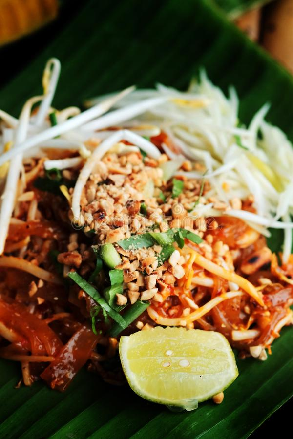Phat thaior Pad thai is a famous Thailand tradition cuisine with fried noodle served on banana leaf. stock image