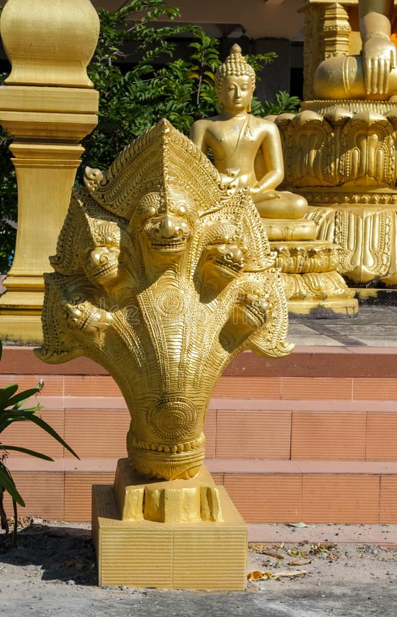 Naga gold dragon snake guard in thai buddhist Temple. Phaya Naga guarding the Temple Wat in Thailand. Nagas asian mythological guard statue in Thai Buddhist royalty free stock photography
