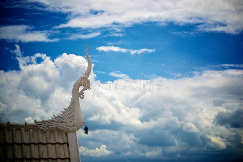 Phaya Nak statue in the sky royalty free stock photo