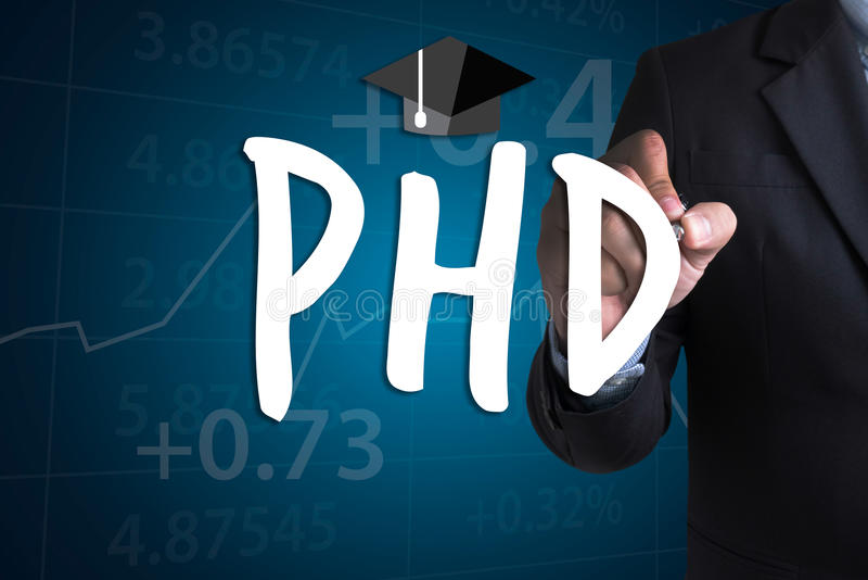 PhD Doctor of Philosophy Degree Education Graduation. Businessman working at office desk and using computer and objects, Gamification Business Concept royalty free stock photo