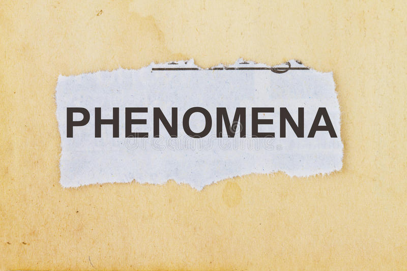 PHENOMENA. Newspaper cutout in an old paper background royalty free stock photography