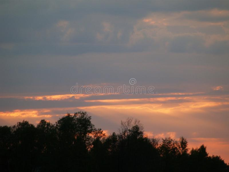 Phenomenal sunset. Over the lake Pasternik with a beautiful sun piercing through the clouds and reflecting off the surface of the water royalty free stock photo