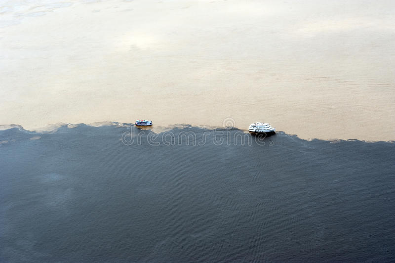 Phenomenon of Amazon - meeting of the waters - aerial view with two steamboats  royalty free stock images