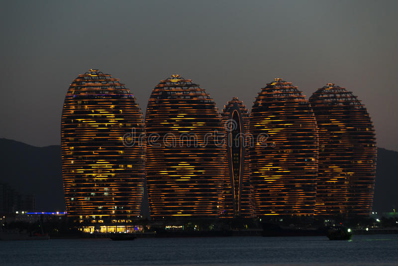 Pheonix Island Sanya, illuminated buildings.Orange Bronze, Unique modern design stock photo