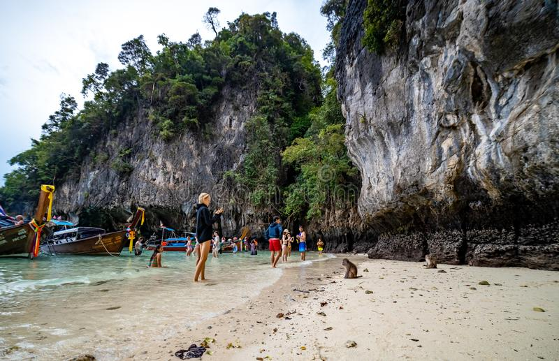 Phi Phi Island, Thailand - November 24 2019: Tourists enjoying their visit to the Monkey Beach on Phi Phi Island. Monkey beach is stock image