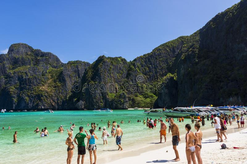 Phi Phi Lay island, Thailand, March 2013 Tourists enjoying a trip to Maya Bay royalty free stock photo