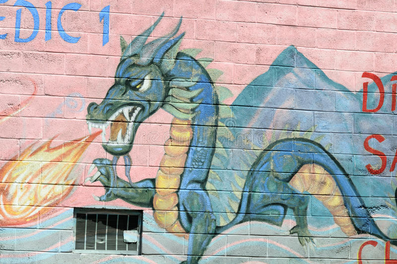 PHILADELPHIA, PA - MAY 14: Fire breathing dragon graffti artwork mural in the Chinatown section of downtown Philadelphia stock photo
