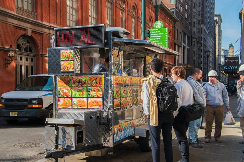 Customers along side a food cart selling Halal food on Broad Street near the Academy of Music royalty free stock photography