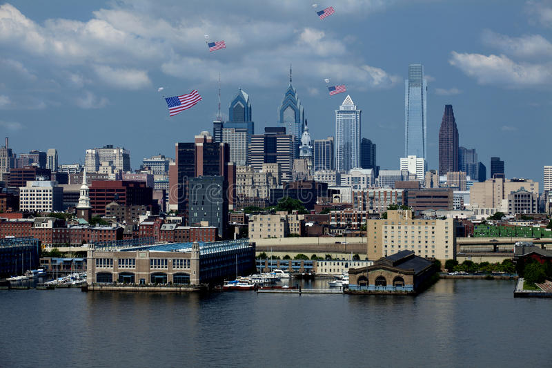 Philadelphia, Pennsylvania - Flag Day 2015. Skydivers parachute into downtown Philadelphia, Pennsylvania with giant American Flags attached to them to celebrate stock image