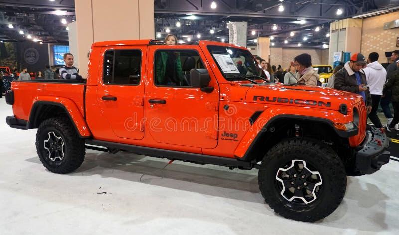Philadelphia, Pennsylvania, U.S.A - February 9, 2020 - A bright orange 2020 Jeep Gladiator Rubicon 4X4 royalty free stock image