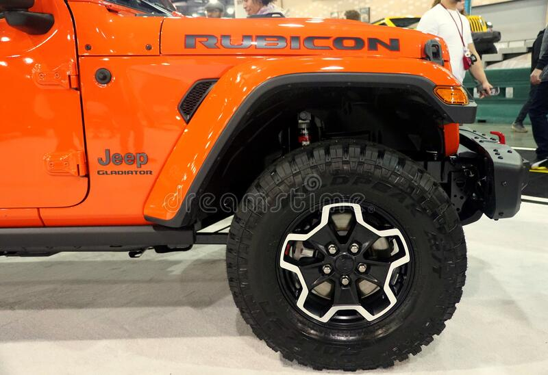 Philadelphia, Pennsylvania, U.S.A - February 9, 2020 - The wheel of the bright orange 2020 Jeep Gladiator Rubicon 4X4 royalty free stock photography