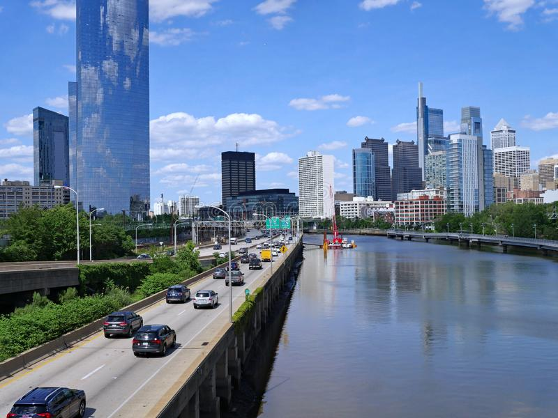 Philadelphia skyline in 2019 with expressway on the west side of the Schuylkill River. And recreational boardwalk along the other bank for cyclists and royalty free stock photo