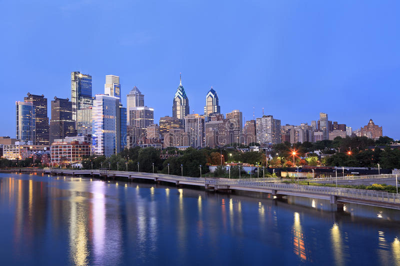 Philadelphia skyline illuminated and reflected into Schuylkill River at dusk. USA stock images