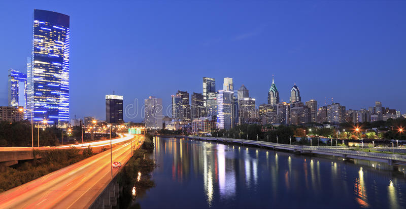 Philadelphia skyline illuminated and reflected into Schuylkill River at dusk. USA royalty free stock photo