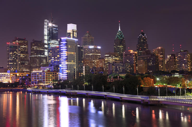 Philadelphia skyline illuminated and reflected into Schuylkill River at dusk. USA stock photo