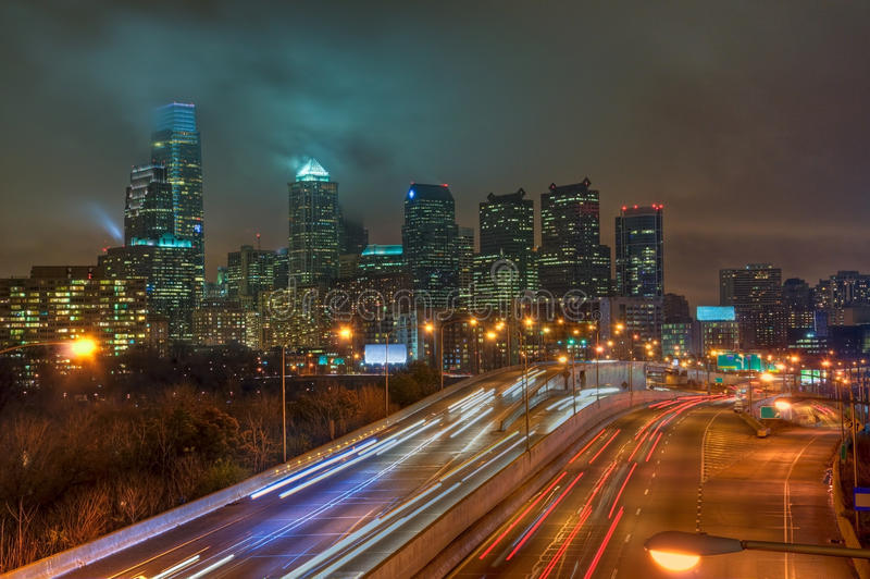 Philadelphia Skyline at Night. The Philadelphia, Pennsylvania skyline at night with the Schuykill Expressway in the foreground stock photography