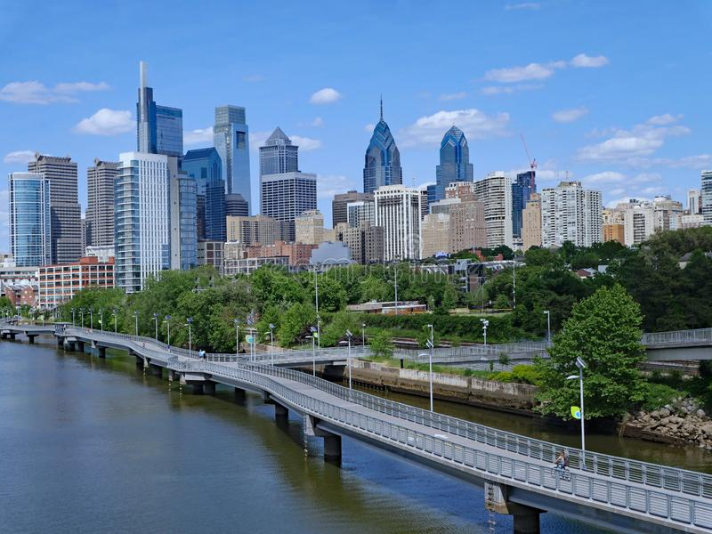 Philadelphia skyline in 2019 with recreational boardwalk along the Schuylkill River royalty free stock photography