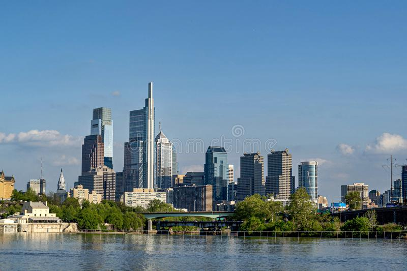 PHILADELPHIA skyline on schuylkill river. The Schuylkill River looking south toward the Philadelphia skyline is the place for training regatta of rowing team royalty free stock photography