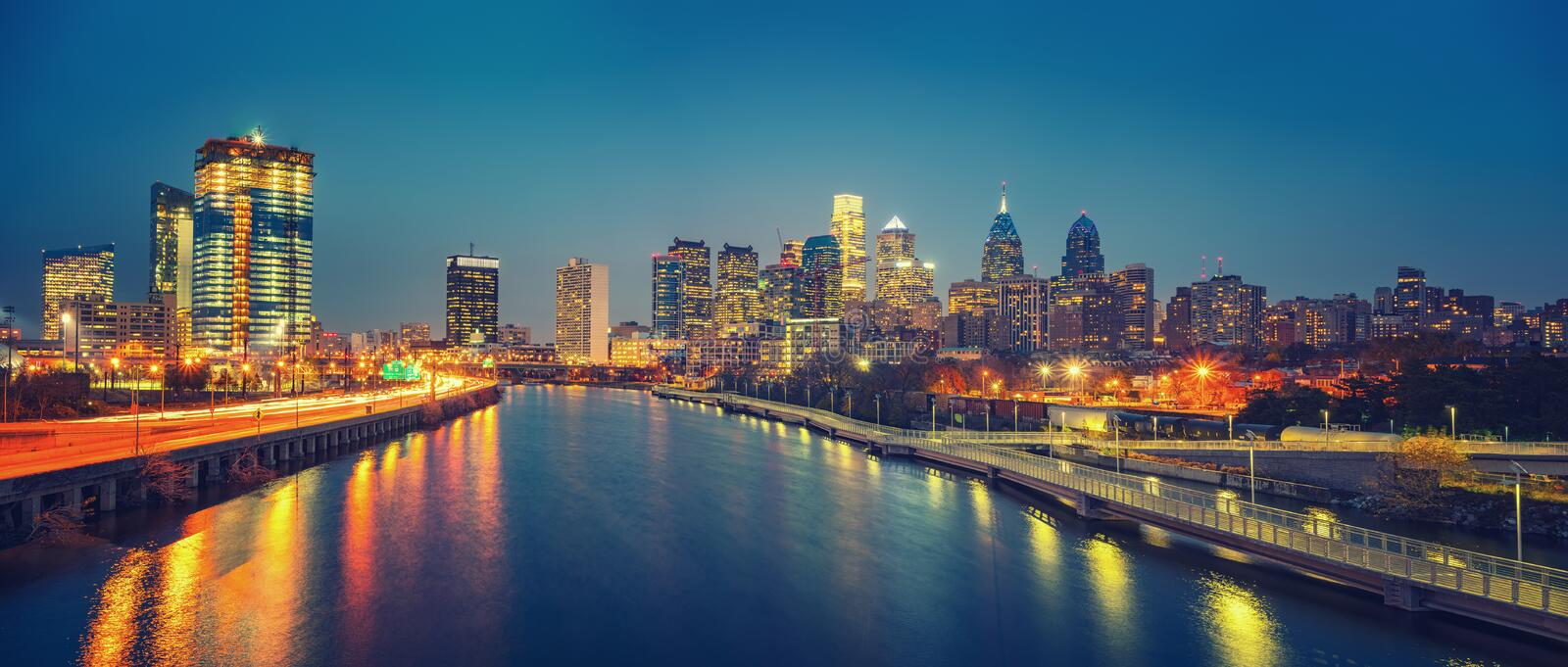 Philadelphia skyline and Schuylkill river at night, USA. Panoramic picture of Philadelphia skyline and Schuylkill river at night, PA, USA stock photo