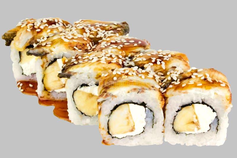 Philadelphia-Sushi mit Banane unagi Soßenindischem sesam lizenzfreie stockfotografie