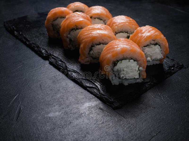 Philadelphia sushi food photography art. Philadelphia sushi rolls on dark background. Food photography art royalty free stock photos
