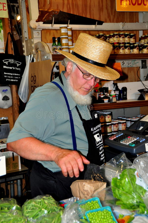 Philadelpjhia, PA: Amish Man Selling Food at Market stock photo