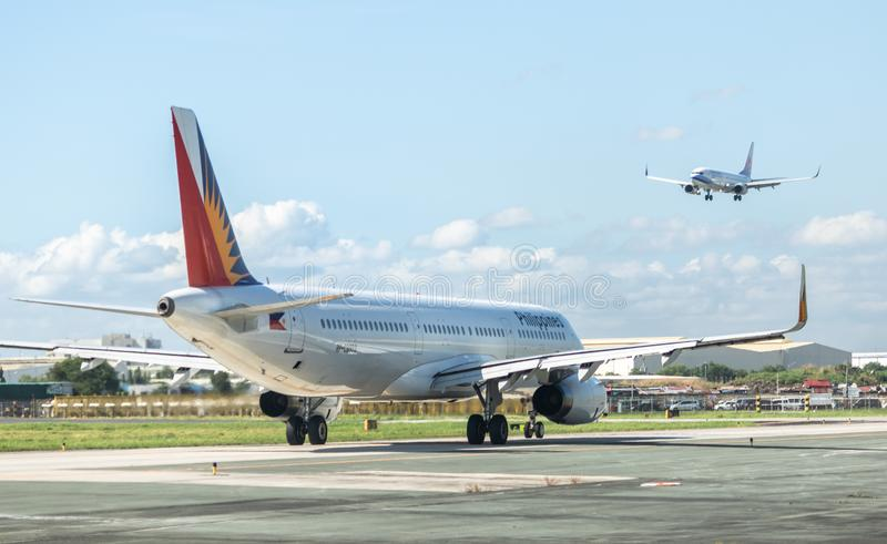 Philippine Airlines sur piste photographie stock