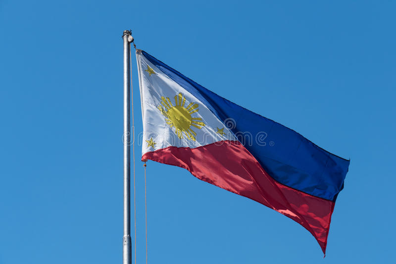 Philippine flag on clear blue sky. Philippine flag waving on the air in Manila, Philippines royalty free stock photography